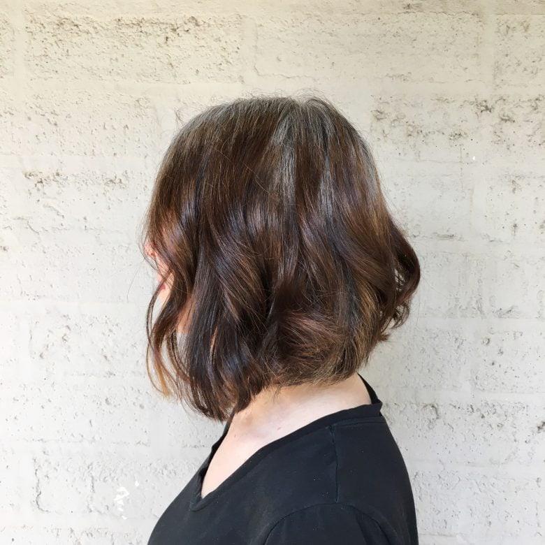 Wavy gray and brown haircut