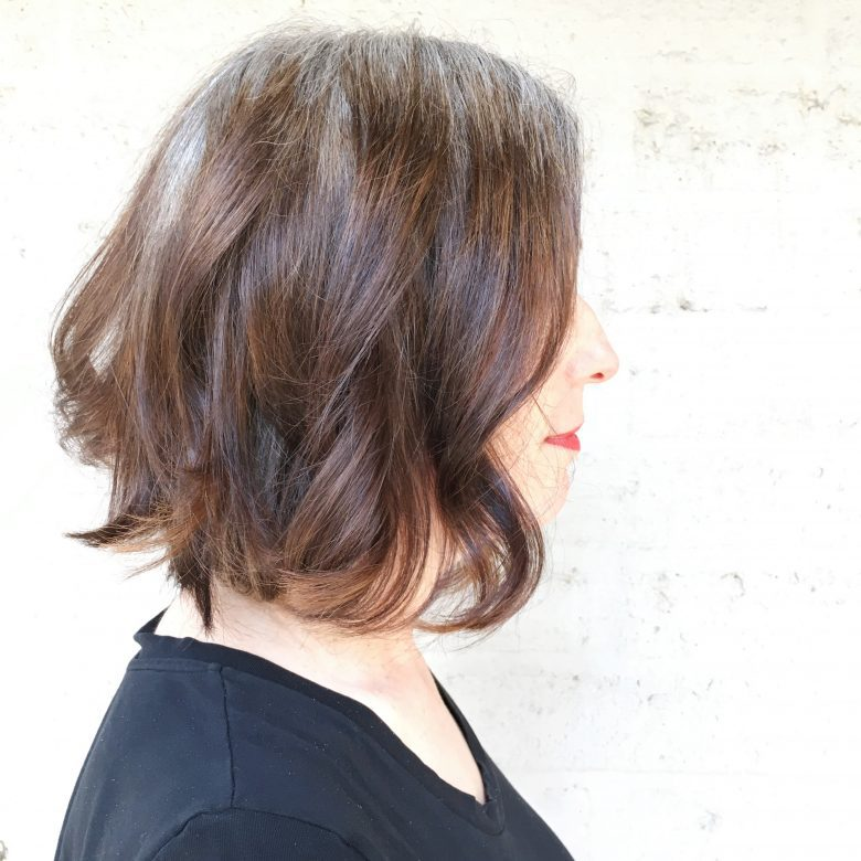 Katie's new haircut is a short bob with light waves and calico colors