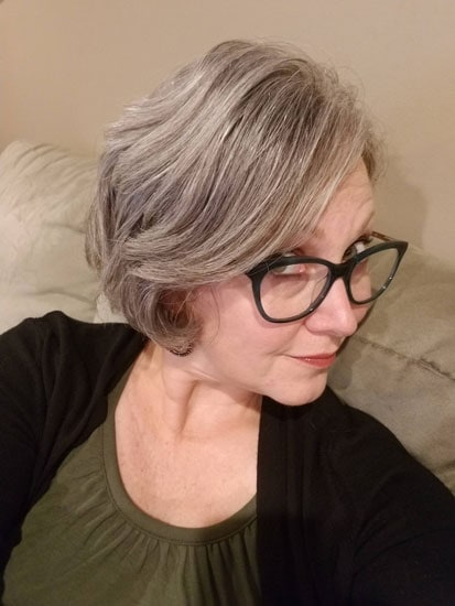 Debbi is loving her short gray bob at the end of her gray hair transition