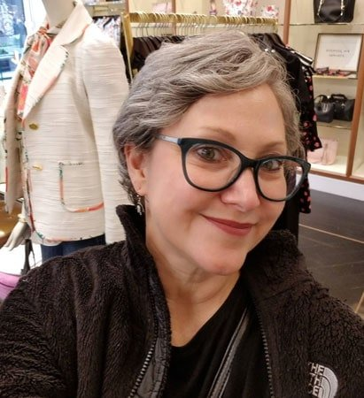 Debbi's short gray hair is looking fab in a whispy pixie cut