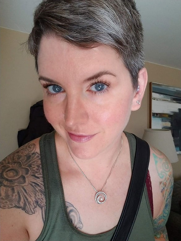 woman blue eyes gray pixie