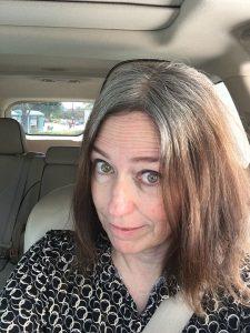 brunette woman gray hair orange brassiness