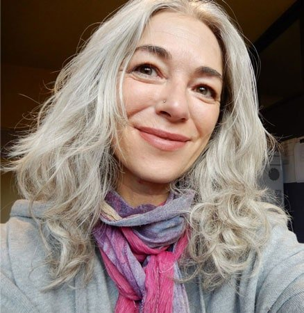 image of a woman with long gray hair