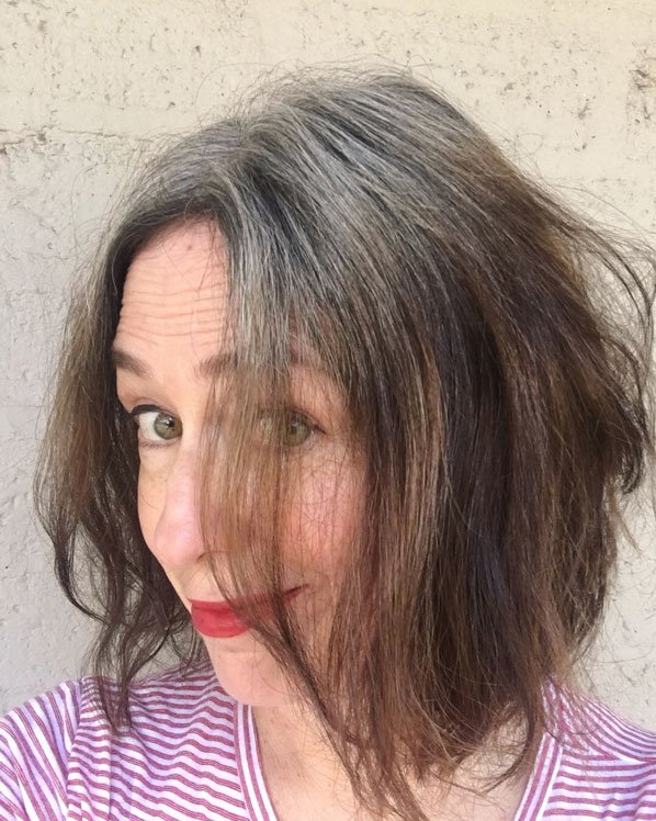 woman striped shirt red lipstick gray hair