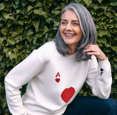 image of woman gray hair white sweater