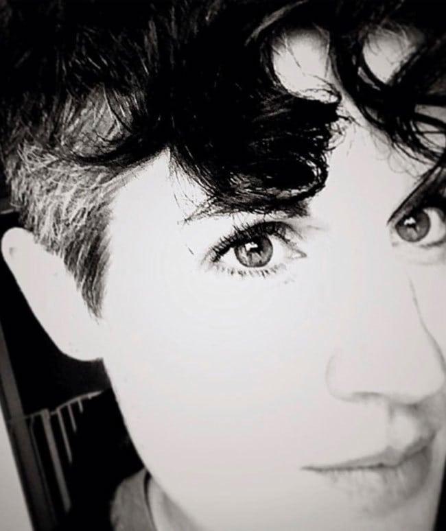 image of woman dark hair gray sides
