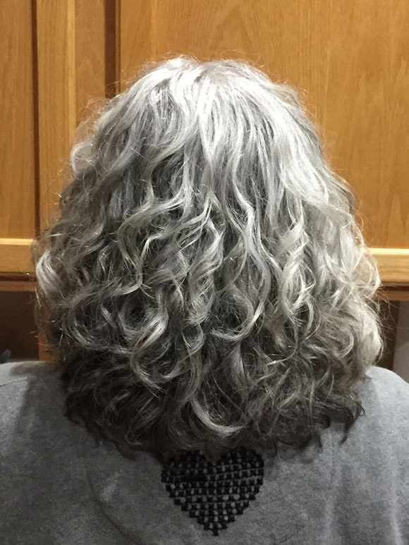 image of woman naturally curly silver hair