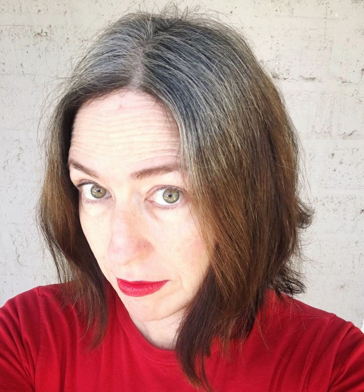 image of woman in red shirt with gray roots