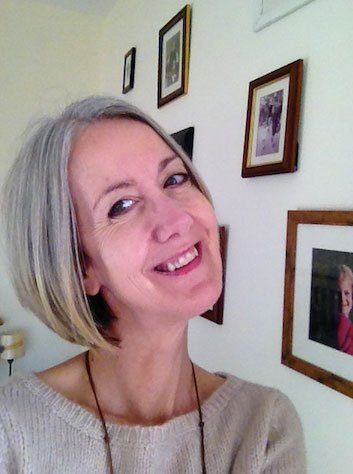 image of woman with gray roots and blonde hair