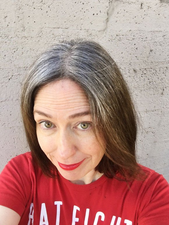 image of woman in red shirt gray hair brown ends