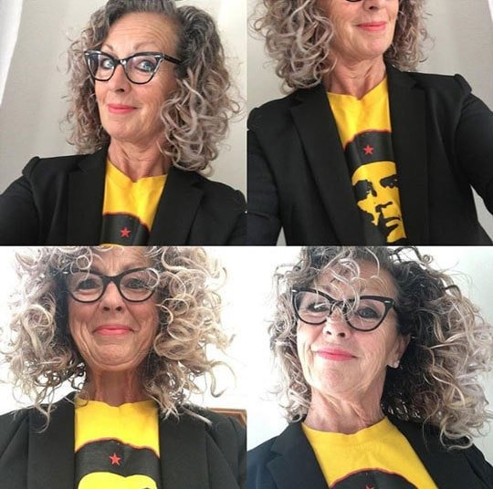 image of woman gray roots yellow shirt