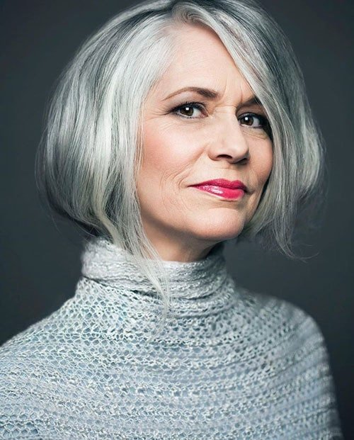 image of pretty woman gray hair and gray sweater