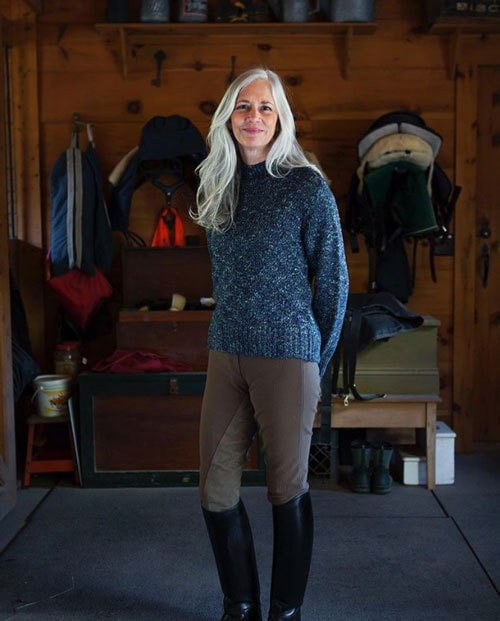 image of pretty woman long gray hair equestrian outfit