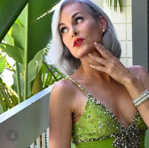 image of beautiful woman green dress gray hair