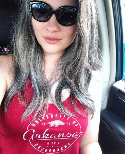 image of pretty young woman long gray hair and red shirt