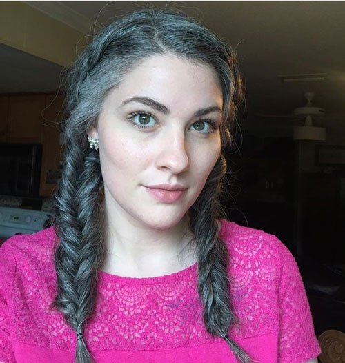 image of pretty woman gray braids and pink shirt
