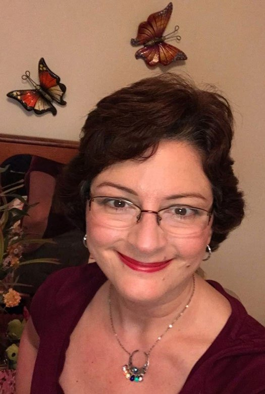 image of pretty woman dark hair glasses