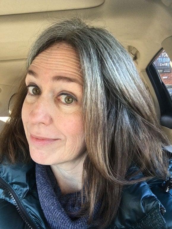 image woman gray roots dark hair