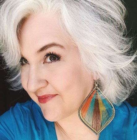 image of woman white hair big earrings