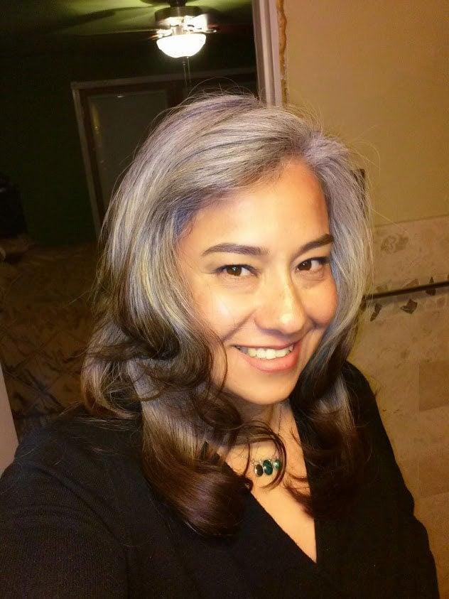 image of latina woman transitioning gray hair