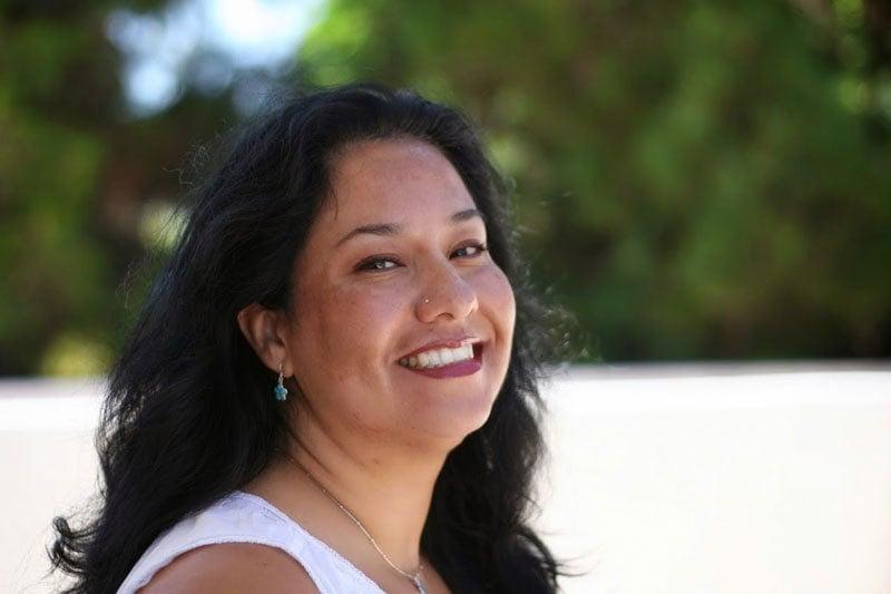 image of latina woman dark long hair