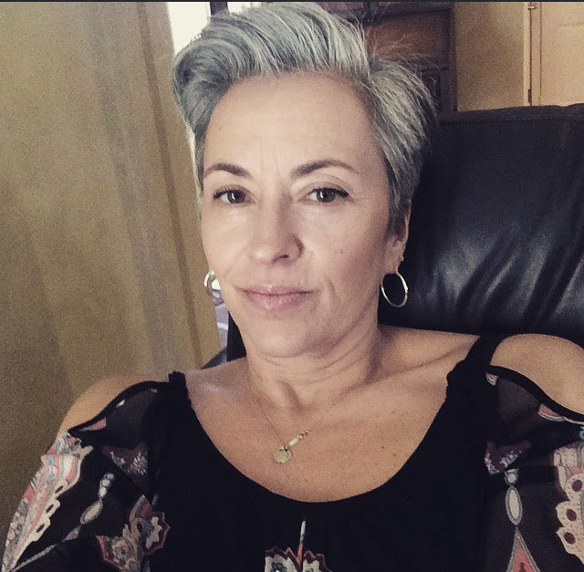 Paula is sporting a short gray pixie cut after her gray hair transition