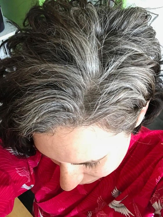 woman top of head gray roots