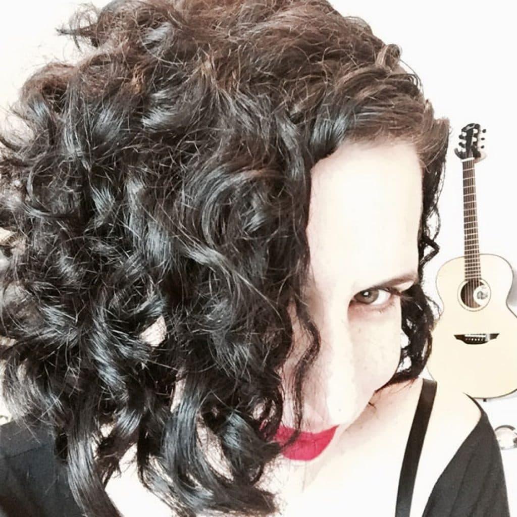 image woman dyed hair black curls