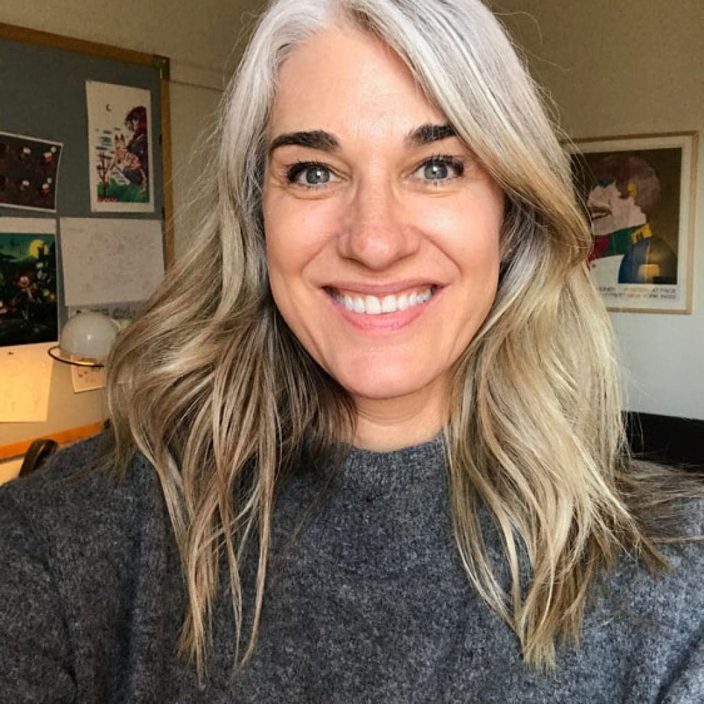 image woman gray roots blonde ends transition to grey with highlights