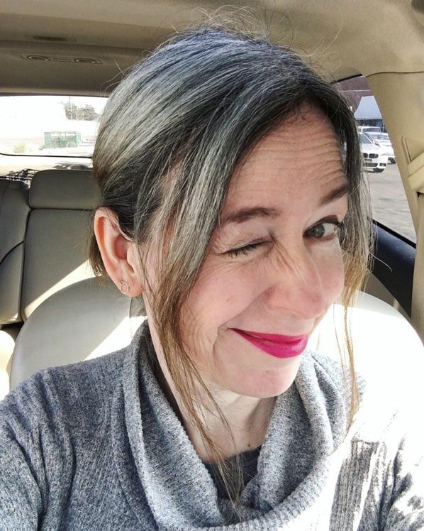 image of woman gray root brown ends 11 months gray progress