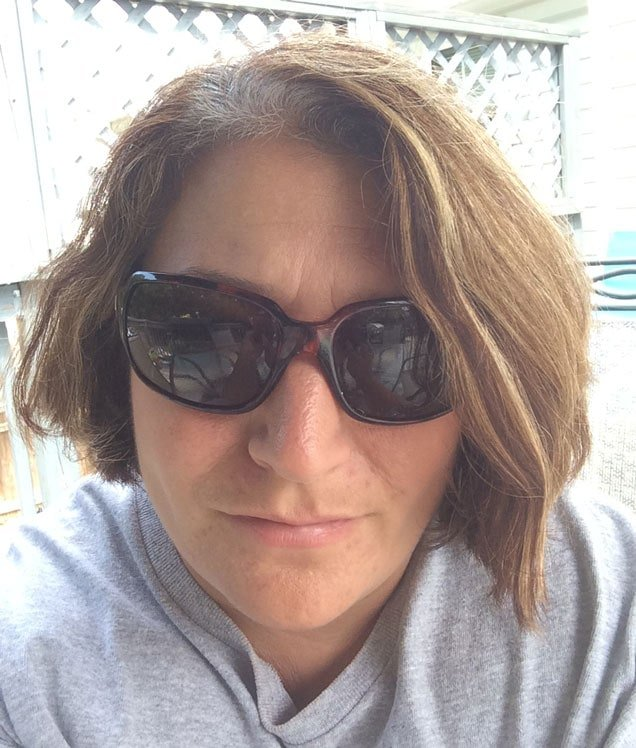 Andrea looks great rocking gray roots with some stylish sunglasses