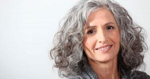 image of woman with grey curly hair