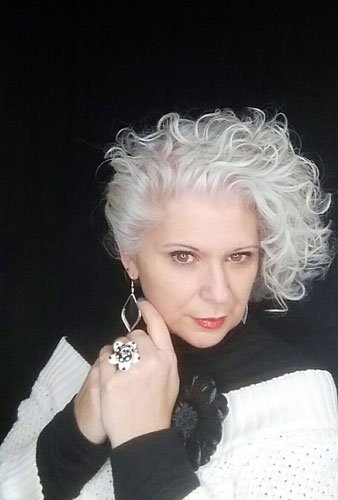 image of woman with curly silver hair