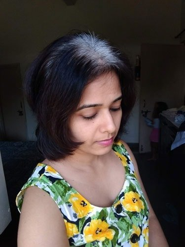 image of young Indian woman going gray