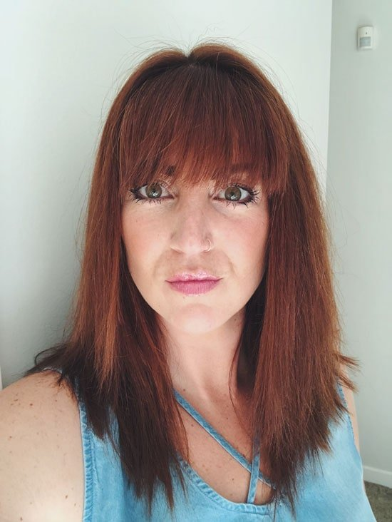 image of woman with dyed red hair
