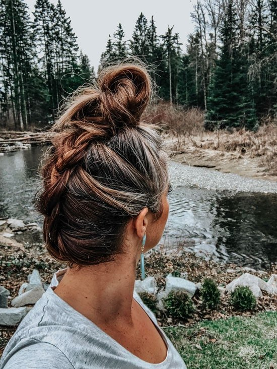 image of woman with greying hair in top knot