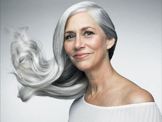 Judith Davis models her flowing, curly gray hair