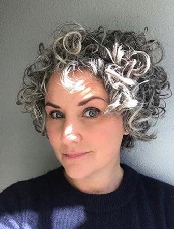 image of woman gray hair blue shirt