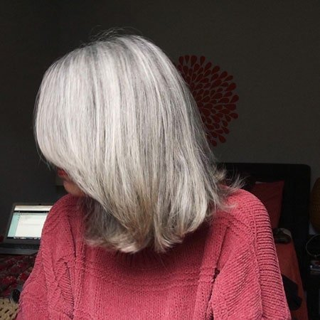 image of woman's transition to gray hair