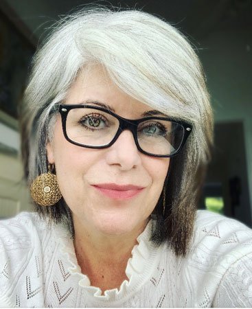 image of woman with gray hair and glasses