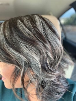 Diana's gray hair is fully peeking through her dark dyed strip