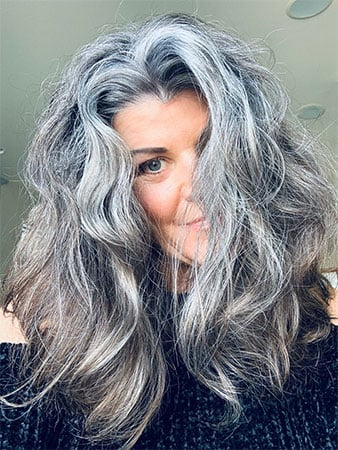 image of 50 year old woman with long gray hair