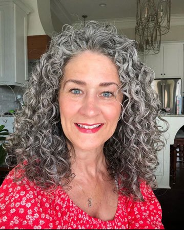 image of woman curly silver hair