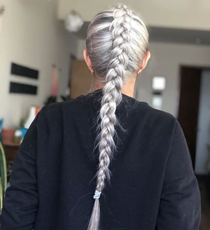 image of woman with gray braid