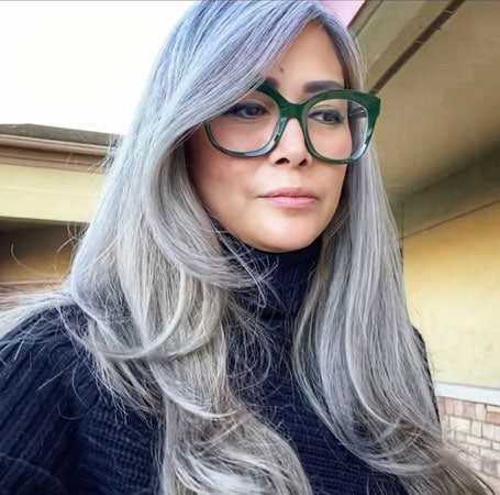 image of gorgeous woman with grey hair and glasses