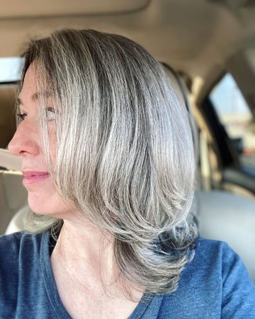 image of side view of layered long grey hair