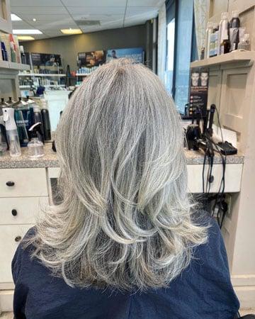 image of long gray haircut at salon