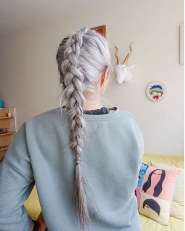image of woman with long gray braid