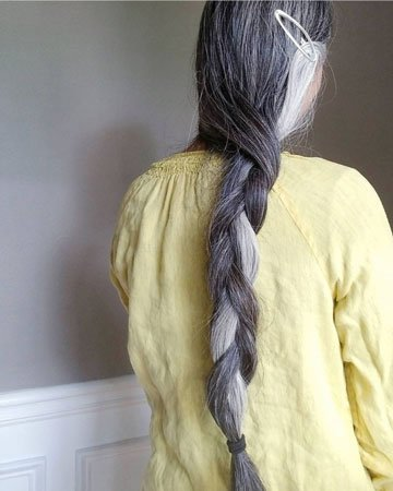 image of woman with long gray and white braid