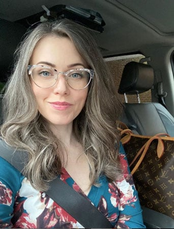 image of young woman long grey hair and glasses
